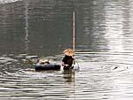 同安の西渓で漁をする人